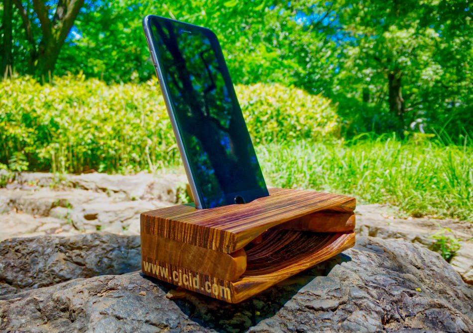 "Side view of the handmade wooden iPhone stand and passive amplifier speaker ""CJ Monster Mouth"" with an iPhone attached"